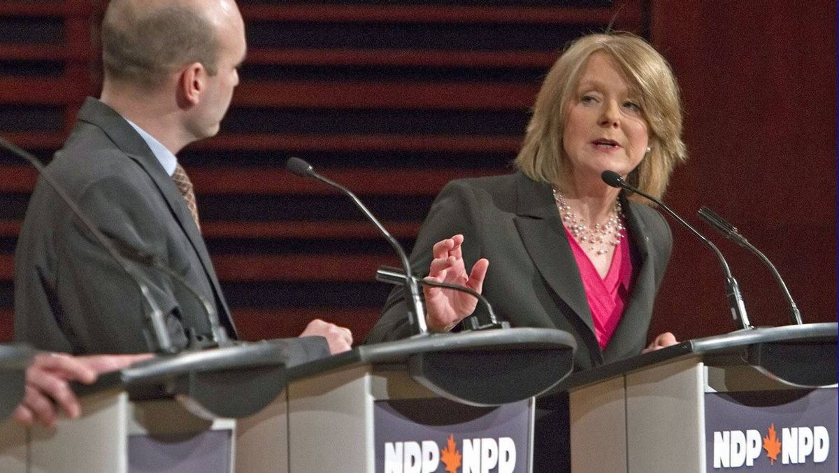 With B.C.'s Nathan Cullen looking on, Toronto MP Peggy Nash responds to a question during an NDP leadership debate in Quebec City on Feb. 12, 2012.