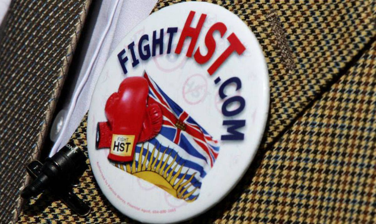 Former British Columbia premier Bill Vander Zalm wears an anti-HST button on his jacket as he waits to board a ferry in Tsawwassen, B.C., on Wednesday June 30, 2010.