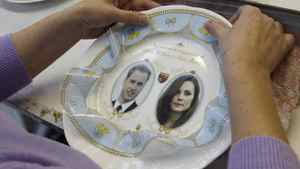 A worker put a transfer onto a souvenir mug, made to mark the engagement between Britain's Prince William and Kate Middleton, at Aynsley China in Stoke-on-Trent, central England. The company has produced mugs and plates as part of a pre-production run prior to full production.