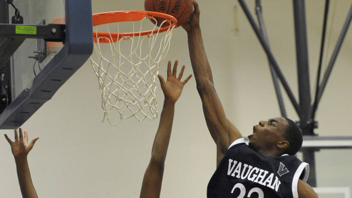 Andrew Wiggins, #22, takes it to the basket during a basketball tournament at Father Henry Carr Catholic Secondary School in Etobicoke, Ont.. (Fred Lum/The Globe and Mail)