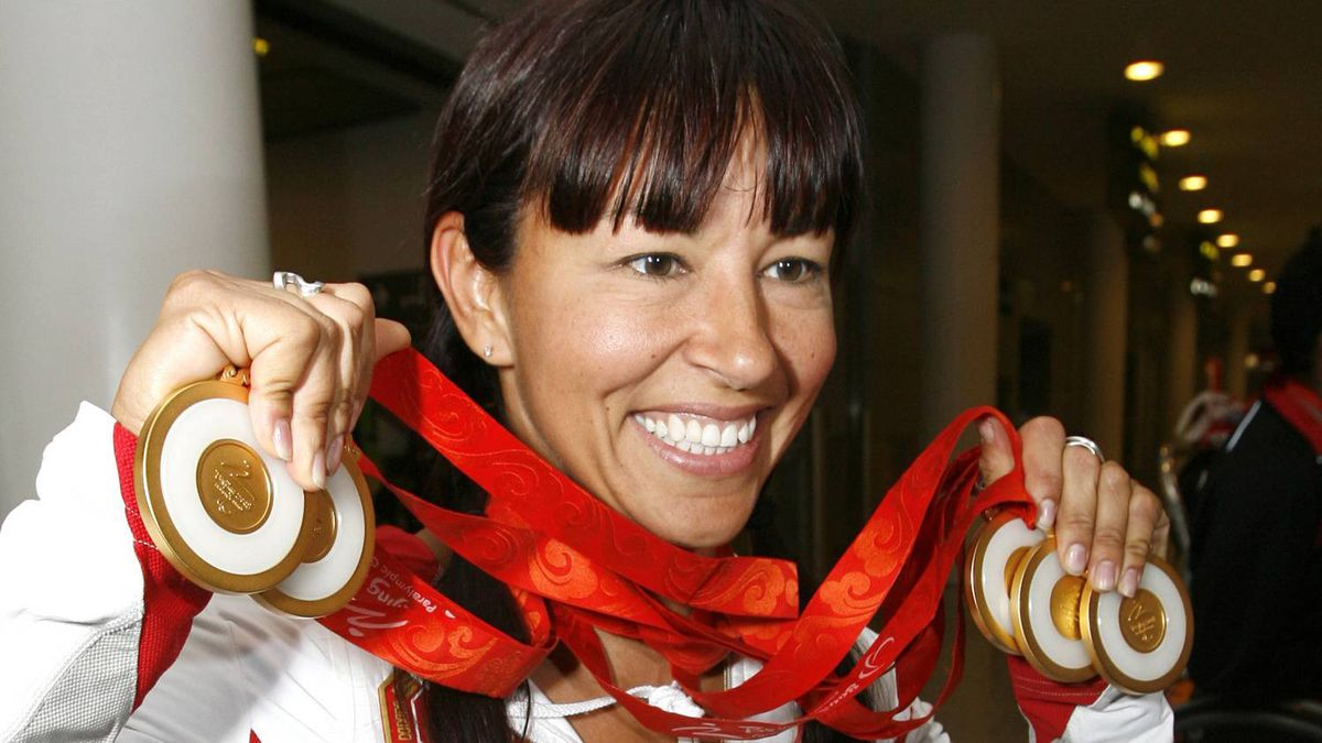 Canadian Paralympic athlete Chantal Petitclerc poses with the five gold medals she won at the Beijing Paralympic Games after arriving at Pearson International Airport in Toronto, September 18, 2008.