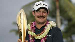 Johnson Wagner of the U.S smiles as he holds the trophy after winning the final round of the Sony Open golf tournament at the Waialae Country Club in Honolulu, Hawaii January 15, 2012.