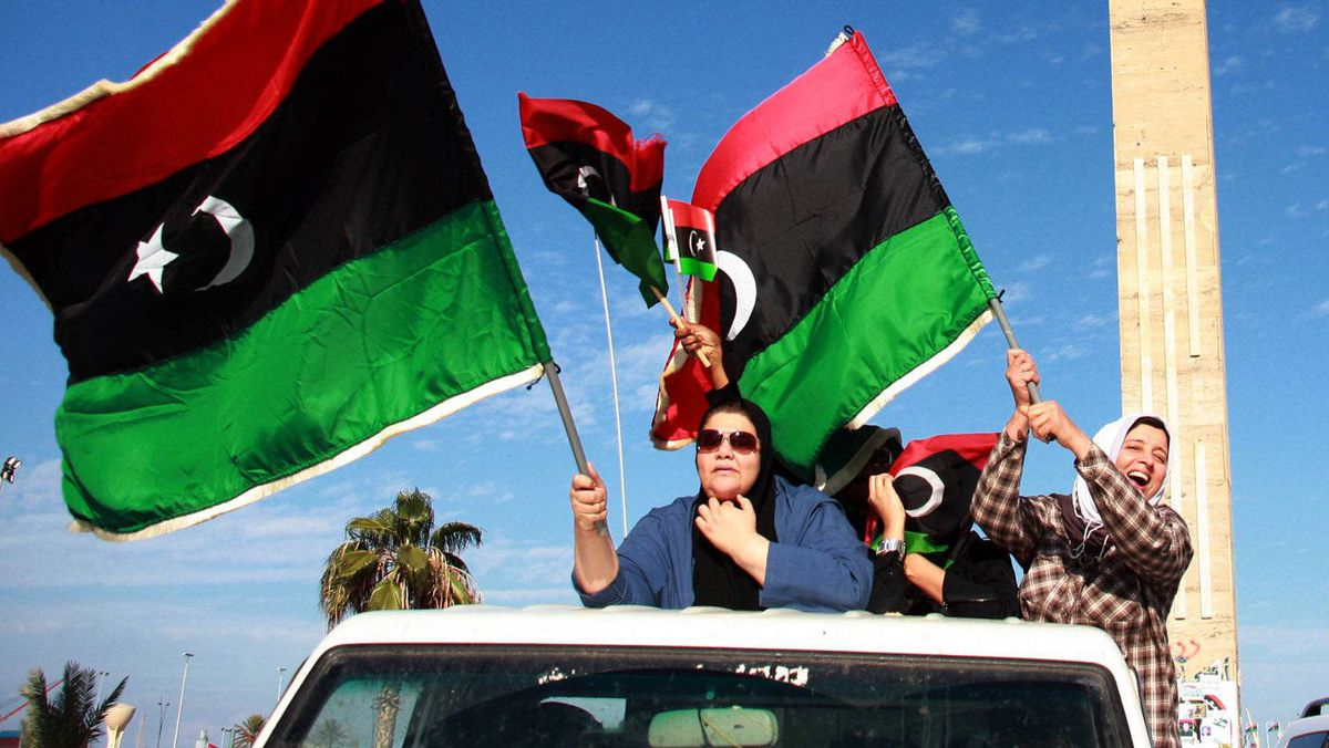 """Libyans celebrate the capture of Saif al-Islam, fugitive son and one-time heir apparent of murdered leader Moamer Kadhafi, in the capital Tripoli on November 19, 2011. Seif al-Islam, 39, who is wanted by the International Criminal Court (ICC), was """"arrested in southern Libya"""" by former rebel forces, National Transitional Council (NTC) justice minister Mohammed al-Allagui told AFP, declining to give any details."""
