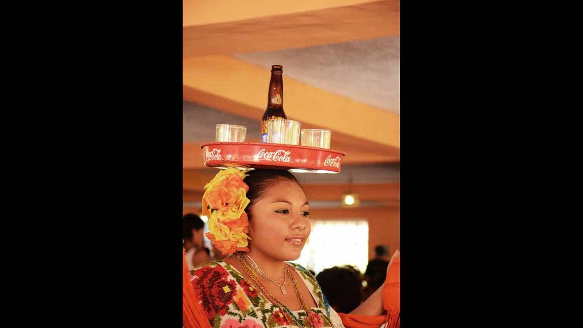 This talented lady was carrying drinks on her head at a stop over restaurant on our way to the Chichen Itza pyramids in Mexico. It was amazing to see her take orders, carry bottles, and dance at times