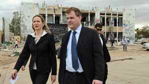 Foreign Affairs Minister John Baird and Canadian Ambassador to Libya Sandra McCardell visit one of Moammar Gadhafi's fortified compounds in Tripoli on OCt. 11, 2011.