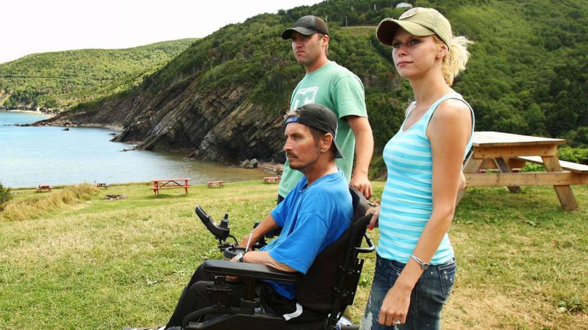 Chris MacKinnon and his wife, Eileen MacLellan, swam, hiked and forded their way to Eileen's father, Kenneth, who uses a wheelchair.