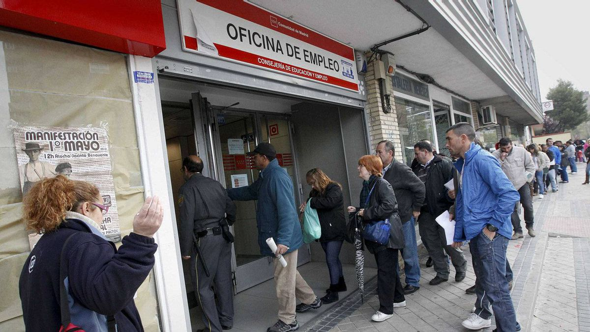 People stand in line to enter a government-run employment office in Madrid April 27, 2012.