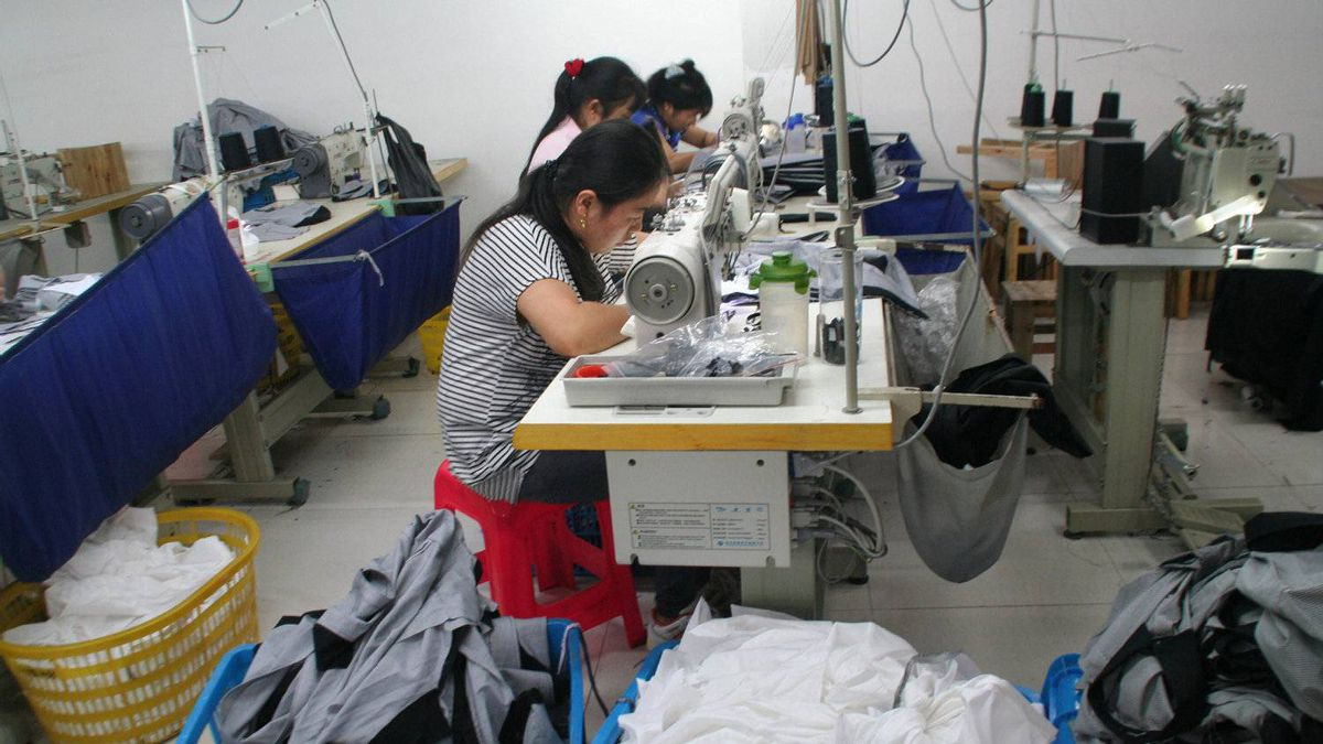 Workers at Wenzhou's Sinoman Clothing Co. The company's owners are days away from having to repay a bank loan of 2 million yuan, money they don't have. 'There's no way to borrow from the banks, and no way to raise money on the private markets,' says founding partner Jin Yanzi.
