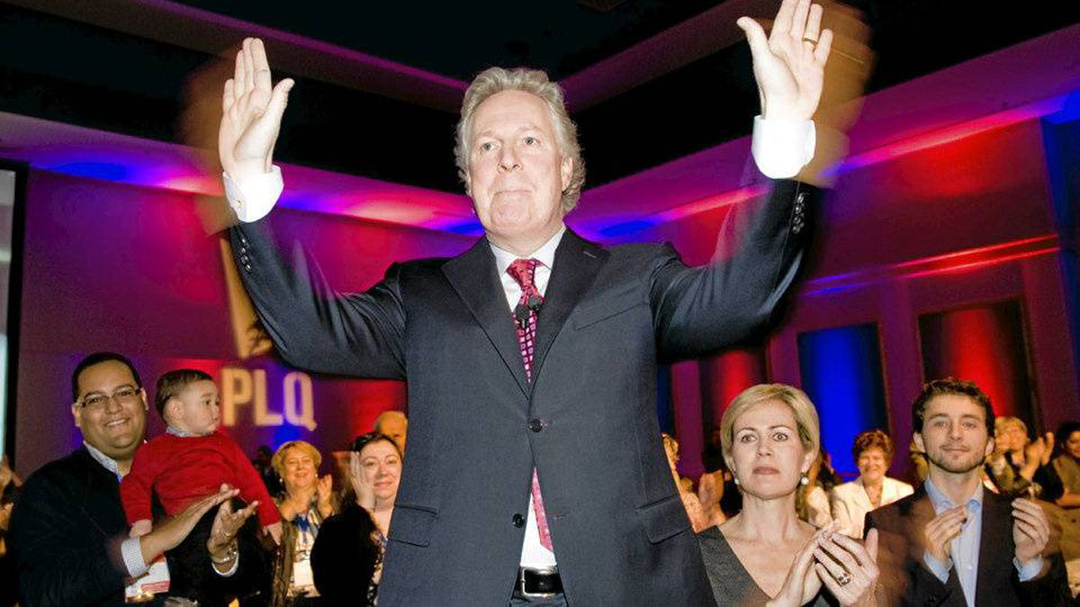 Quebec Liberal party leader Jean Charest waves to supporters as his wife Micha�le Dionne looks on at a Liberal party council general meeting in Saint Hyacinthe, Que., Sunday, April 18, 2010.