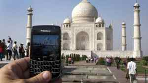 A BlackBerry is used to take a photo of the Taj Mahal Thursday, October 14, 2010 in Agra.