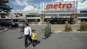 Shoppers leave a Metro store in Toronto.