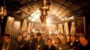 Christian pilgrims pray at the Grotto in the Church of the Nativity on December 22, 2011 in Bethlehem, West Bank.