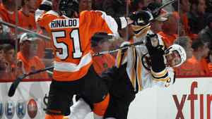 Zac Rinaldo #51 of the Philadelphia Flyers hits Patrice Bergeron #37 of the Boston Bruins. (Photo by Bruce Bennett/Getty Images)