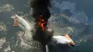 This April 21, 2010 file photo shows the Deepwater Horizon oil rig burning after an explosion in the Gulf of Mexico, off the southeast tip of Louisiana. Decisions intended to save time and money created an unreasonable amount of risk that triggered the largest offshore oil spill in U.S. history, a disaster that could happen again without significant reforms by industry and government, the presidential panel investigating the BP blowout concluded Wednesday, Jan. 5, 2011.
