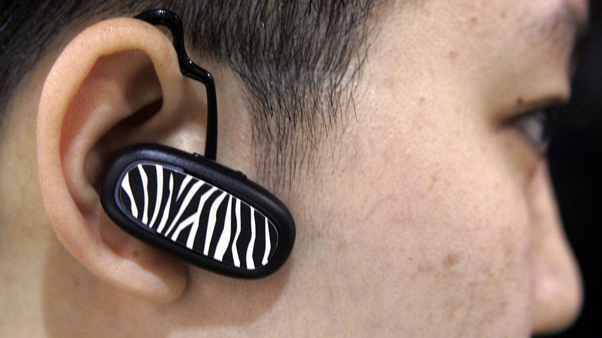 An attendee at the Consumer Electronics Show in Las Vegas tests a Bluetooth device.