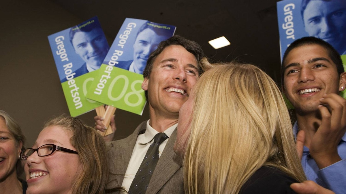 Gregor Robertson celebrates with his family, wife Amy Robertson, daughters Terra and Hanna Robertson and his son Jinagh Navas Rivas, after being elected the Vision Vancouver Mayoral candidate on June 15, 2008.