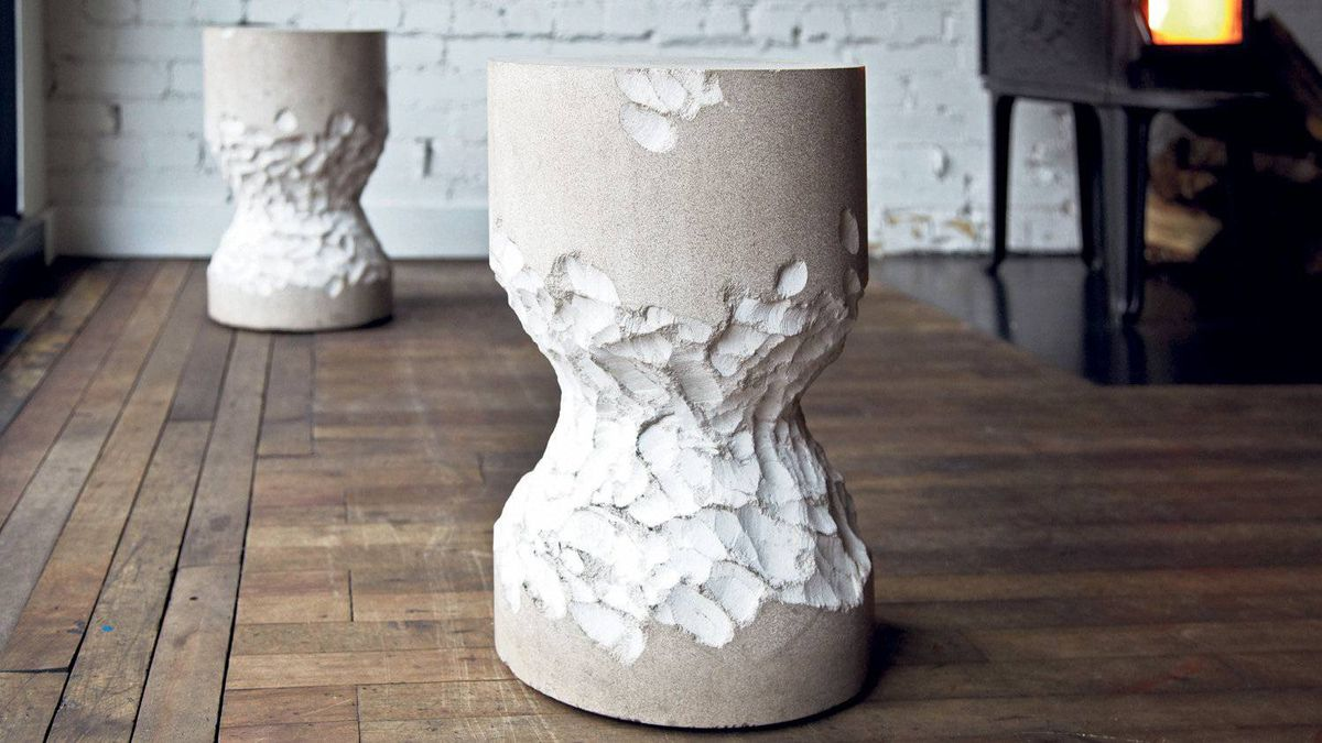 Beaver Stool, a hand-carved limestone seat resembling a knawed tree.