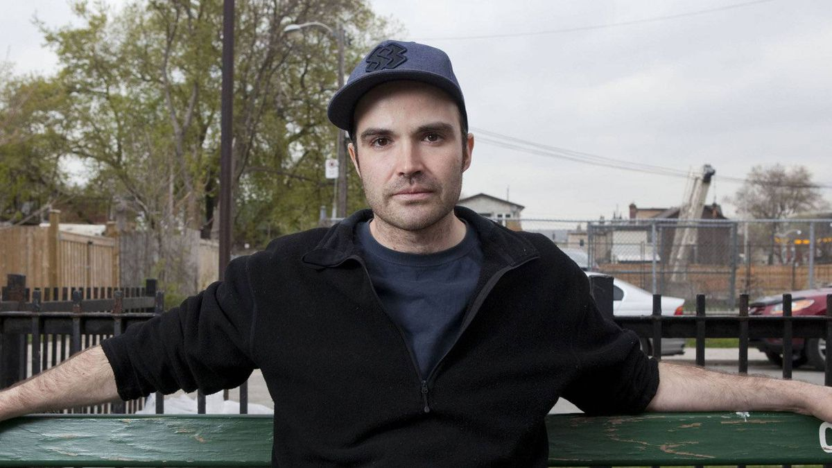 Aaron Simkin, 32, poses for a photograph near his Queen Street East apartment on Tuesday, May 1, 2012.