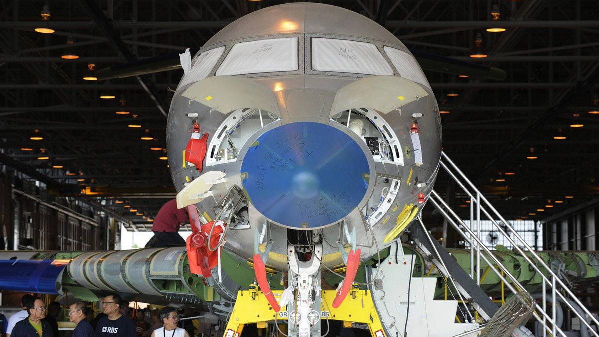 Bombardier employees work on a Global Express jet, an ultra-long-range corporate aircraft first launched in 1993.