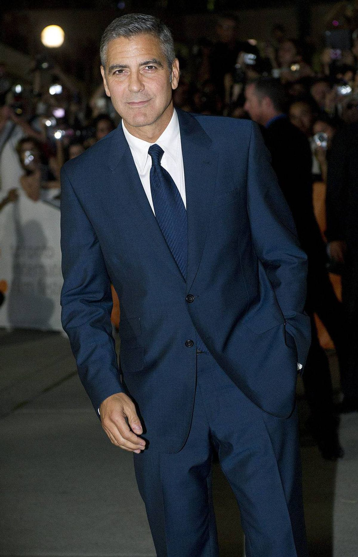 "George Clooney poses on the red carpet before the screening of ""The Ides of March"" at the Toronto International Film Festival on Friday, Sept., 9, 2011."