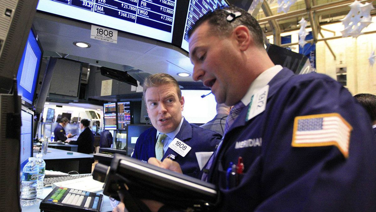 Traders work on the floor of the New York Stock Exchange January 4, 2012.