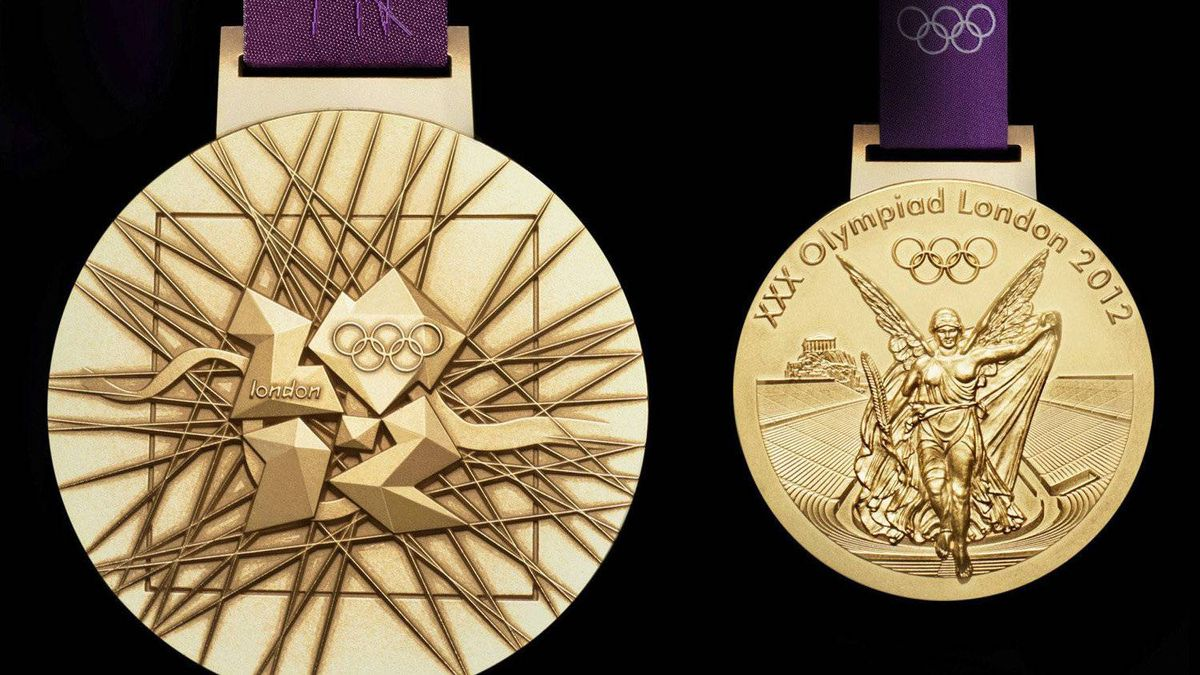 In this image made available by the London Organising Committee of the Olympic Games on Wednesday July 27, 2011 shows London 2012 Olympic gold medal designed by British artist David Watkins. The front of the medal is on the right, all medals are 85mm in diameter. With one year to go until the opening ceremony of the 2012 Olympic Games, London organizers completed the last of the Olympic Park's permanent venues Wednesday July 27, 2011 and promised to put on a safe and spectacular event that will captivate the world. (AP Photo/LOCOG, HO)