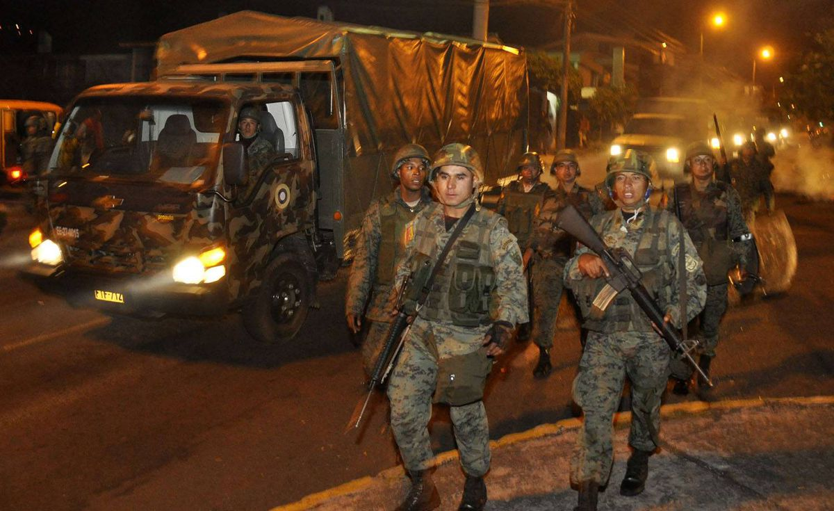 Soldiers arrive outside the hospital where Ecuador's President Rafael Correa was holed up, in Quito. Elder Bravo/Reuters