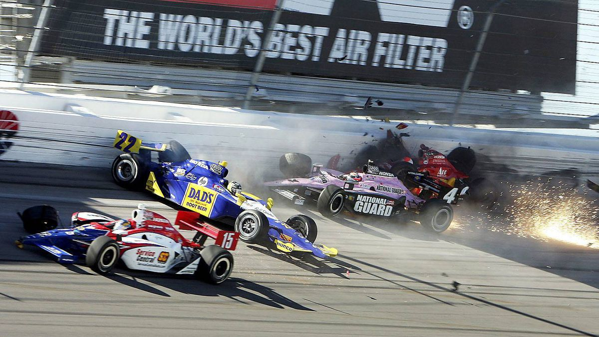 The race cars of drivers Wade Cunningham (R), J.R. Hildebrand (2nd R) and Townsend Bell (2nd L) hit the wall next to Jay Howard (L) during the IZOD IndyCar World Championship race at the Las Vegas Motor Speedway in Las Vegas, Nevada October 16, 2011.