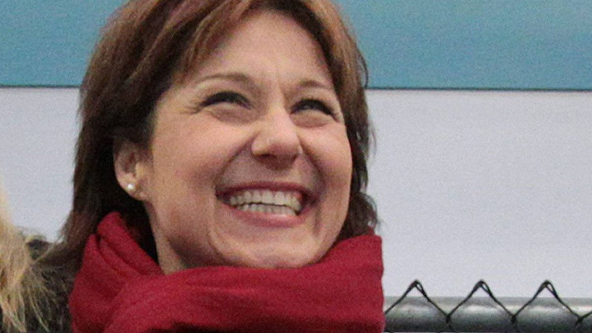British Columbia premier-designate Christy Clark, left, laughs as she watches her nine-year-old son's hockey game in Vancouver, B.C., on Sunday February 27, 2011.