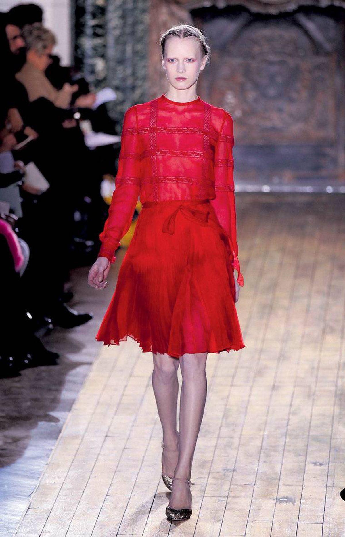 At Valentino, Maria Grazia Chiuri and Pier Paolo Piccioli showed ultra-feminine looks, including blush-toned ruffles and dresses in the label?s signature shade of red.