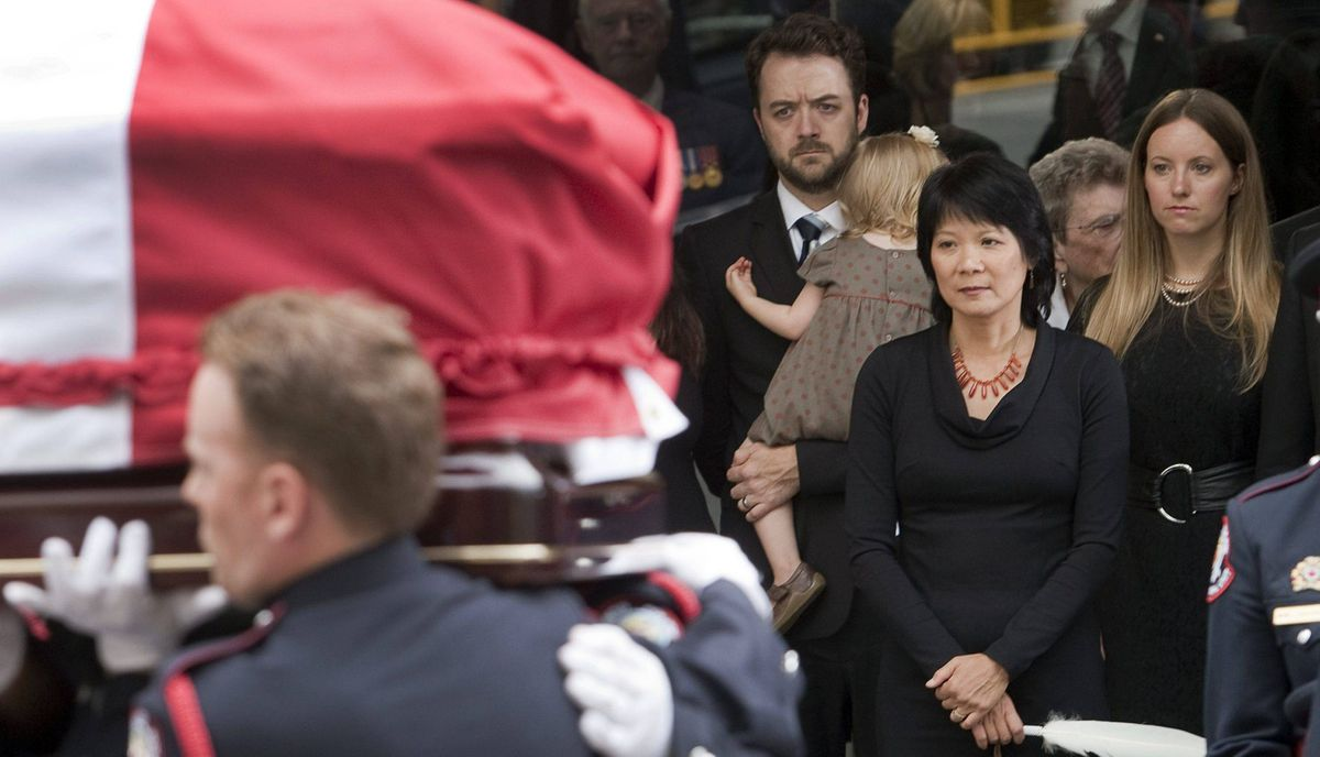 Olivia Chow and family members look on as the coffin of NDP leader Jack Layton leaves Roy Thomson Hall after his state funeral.