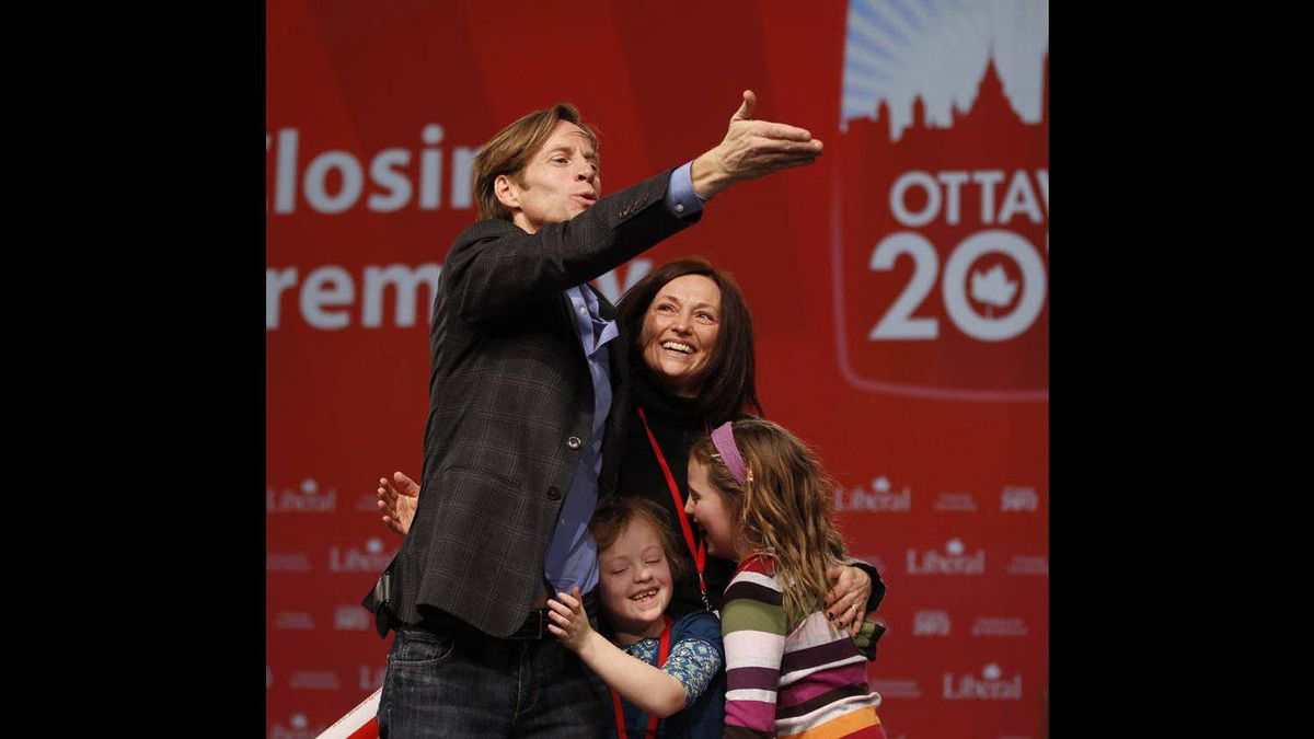 New President of the Liberal Party of Canada, Mike Crawley, blows a kiss, while his daughters, Paige, 9, and Meghan, 7, in blue, and his wife, Heather Crawley share in the victory moment.