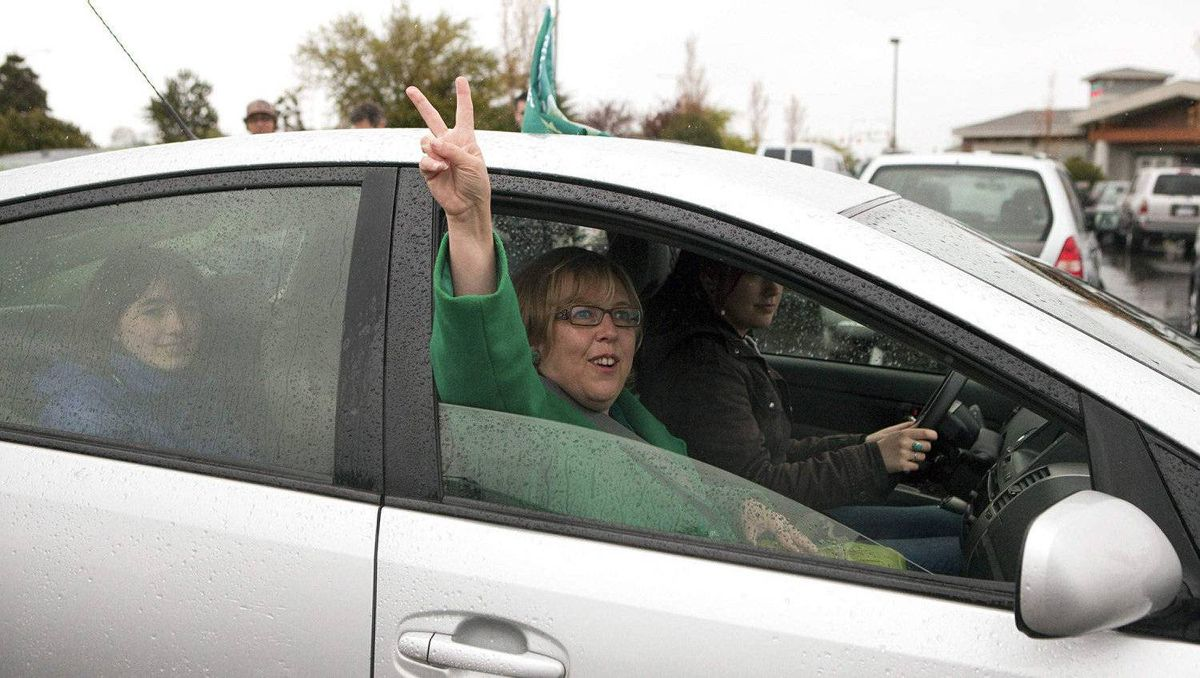 Leader of the Green Party of Canada Elizabeth May leaves a polling station after casting her vote in Sydney, British Columbia May 2, 2011. May is pictured with her daughter Victoria-Cate (backseat).