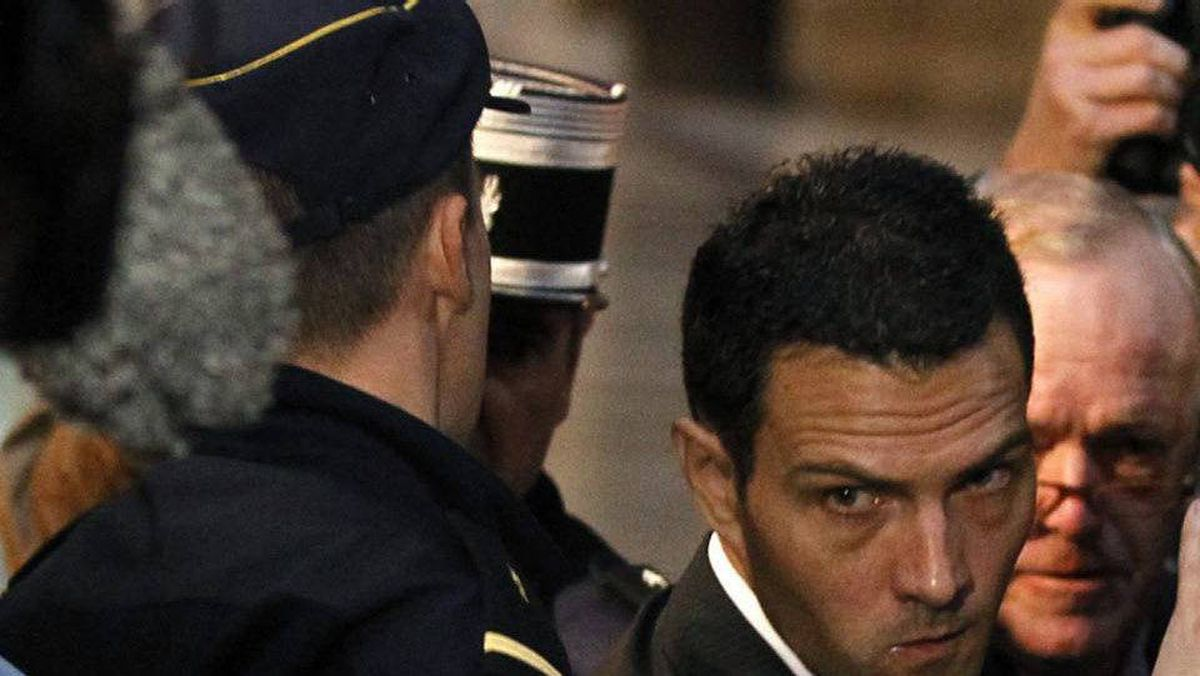 Former trader Jerome Kerviel, centre, arrives at Paris courts for the verdict in his trial.