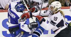 Finland's Marjo Voutilainen, left, is hit by USA's Giji Marvin during a game in Vancouver on Aug. 31.