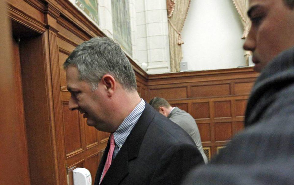 Guy Giorno, Prime Minister Stephen Harper's chief of staff, leaves a Parliament Hill committee room after testifying in an access to information hearing on April 13, 2010.