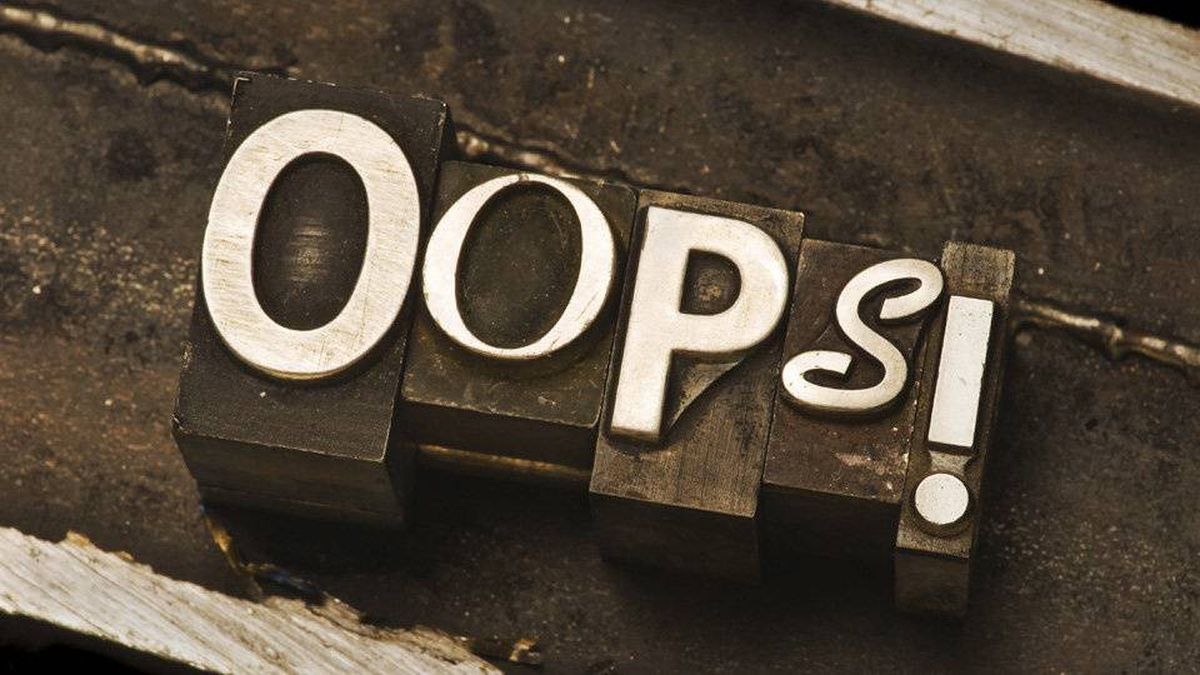 """""""Oops!"""" photographed using a mix of vintage letterpress characters."""