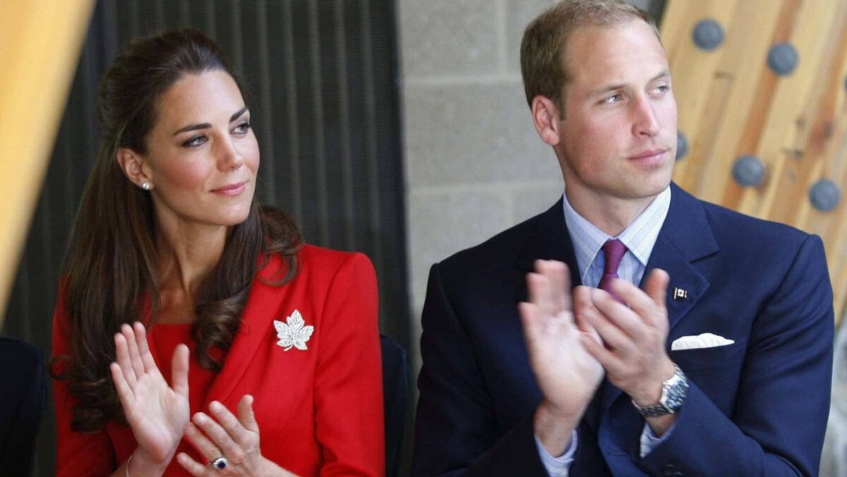 The Duke and Duchess of Cambridge applaude during a tour of the ENMAX Conservatory at the Calgary Zoo in Calgary, Friday July 8, 2011.