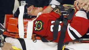 Chicago Blackhawks' Marian Hossa is taken off the ice on a stretcher after being injured following a check by Phoenix Coyotes' Raffi Torres during Game 3 of their NHL Western Conference quarter-final playoff hockey game in Chicago, Illinois April 17, 2012. REUTERS/Jim Young