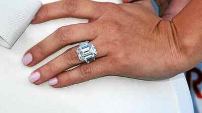 Kim Kardashian shows off her engagement ring at AmberLounge Fashion Monaco 2011 on May 27, 2011 in Monaco.