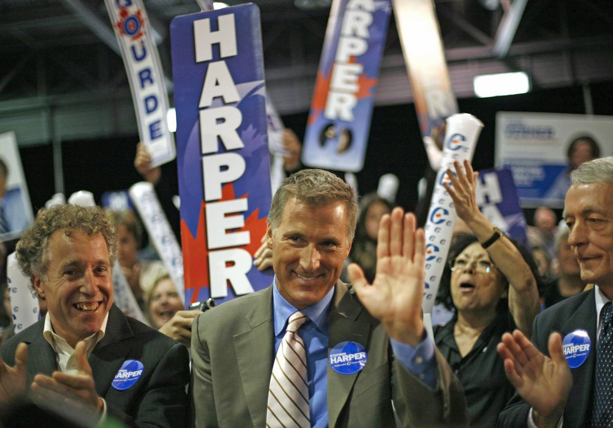 Conservative candidate Maxime Bernier acknowledges applause during a Quebec City election rally on October 12, 2008.