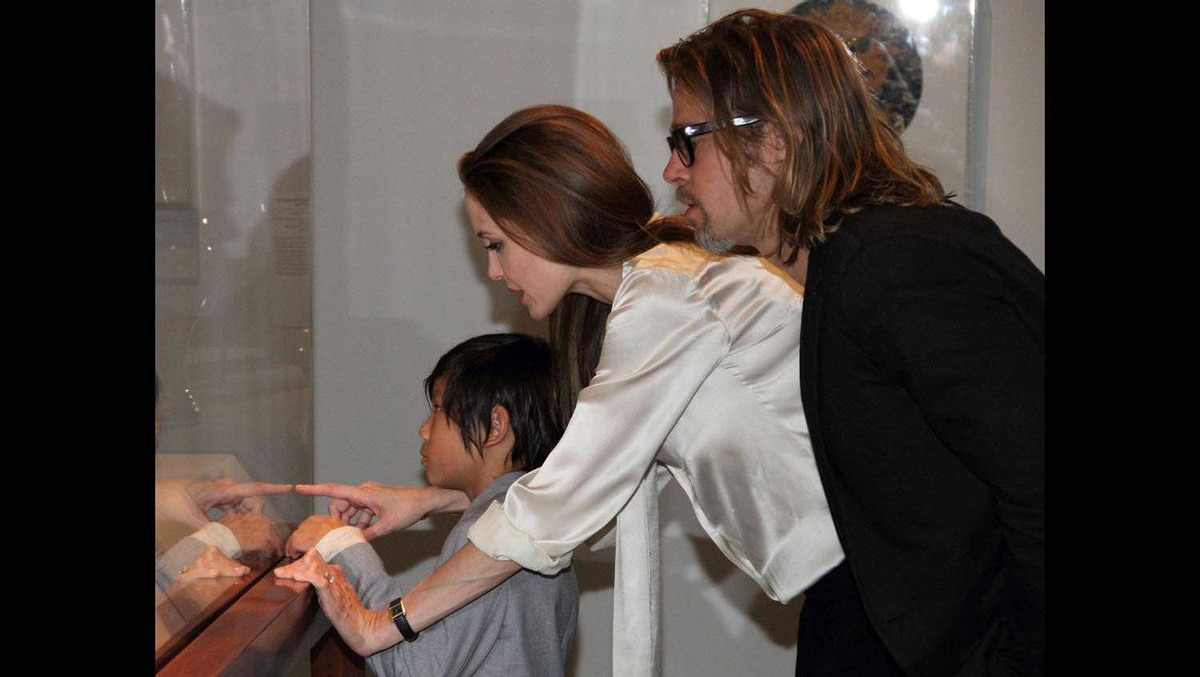 In this April 11, 2012 photo released by The Los Angeles County Museum of Art, actress Angelina Jolie, center, sports an engagement ring as she and Brad Pitt, and their son, Pax view works from the Chinese collection at the The Los Angeles County Museum of Art, in Los Angeles.