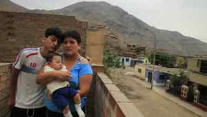 Giovanna Figueroa (wife of injured Peruvian Javier Alba) accompanied by her two sons Sulman, 14, and Ashraf Alba (six months old) at their home in Comas, Peru.