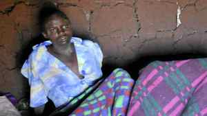 A teenager from Uganda's Sebei tribe sits inside a mud hut after undergoing female genital mutilation in Bukwa district, about 357 kms (214 miles) northeast of Kampala, December 15, 2008. The ceremony was to initiate teenage girls into womanhood according to Sebei traditional rites.
