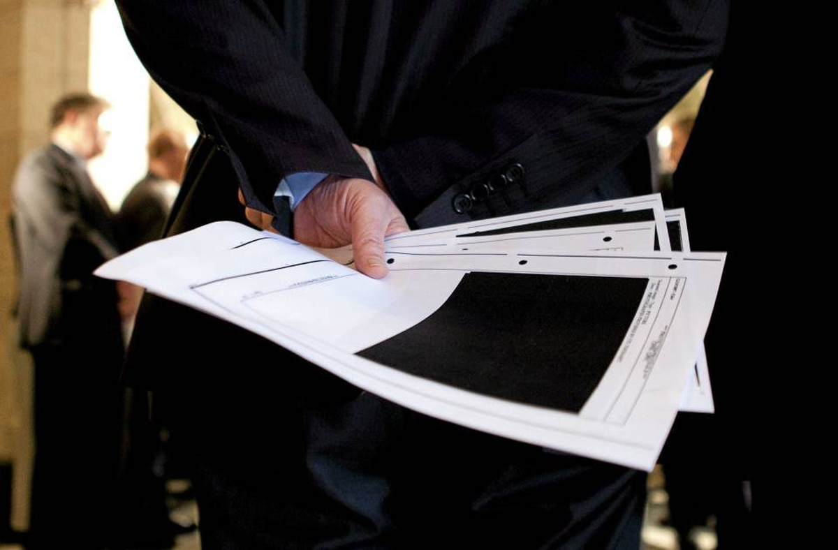Bob Rae holds redacted documents on Afghan detainees tabled by the Conservatives in the House of Commons in April, 2010.