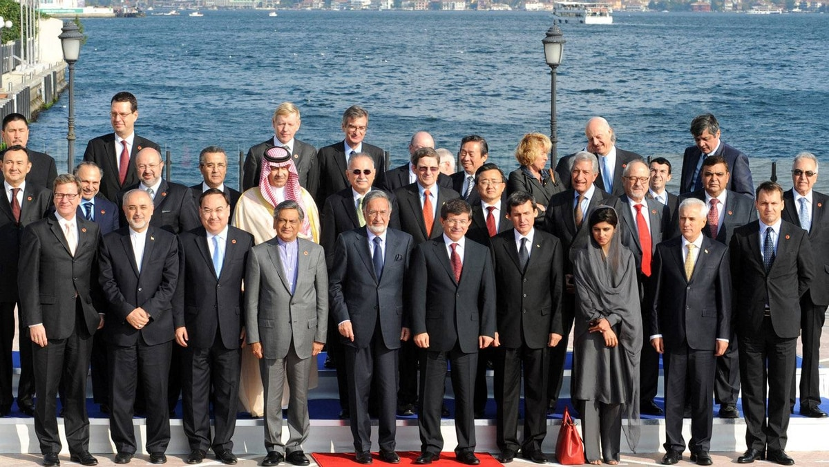 Participators pose for a group photo session during the Istanbul Conference for Afghanistan at Ciragan Palace in Istanbul on November 2, 2011.
