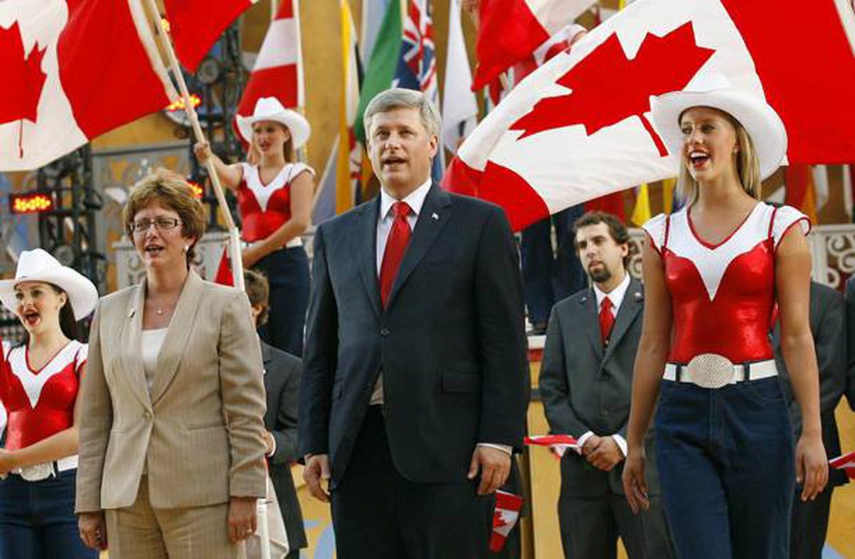 Prime Minister Stephen Harper sings the national anthem at the opening ceremonies for the World Skills Competition in Calgary, Sept. 1, 2009.