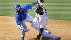 Detroit Tigers runner Austin Jackson is tagged out trying to steal second base by Toronto Blue Jays shortstop Adeiny Hechavarria during the third inning of their MLB Grapefruit League baseball game in Lakeland Florida, March 5, 2012.