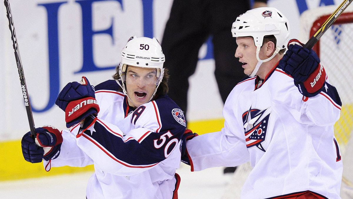 Columbus Blue Jackets' Antoine Vermette (L) celebrates his goal against the Calgary Flames with teammate Derek Dorsett during the first period of their NHL hockey game in Calgary, Alberta, December 1, 2011.