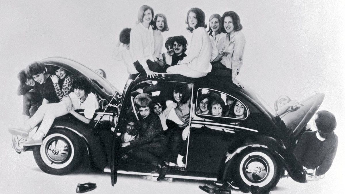 College students jam themselves into a mid-1960s Beetle. The orginal Beetle became an icon of the free love era.